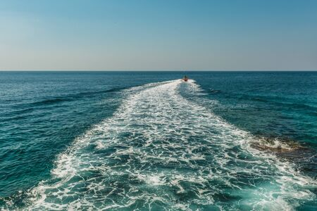 A trace on the surface of the Adriatic Sea behind a speed boat near the city of Budva, Montenegro.