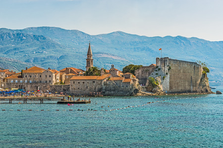 Budva, Montenegro - August 18, 2017: View of the old town and the citadel. Budva is one of the best preserved medieval Mediterranean cities. The Balkans, the Adriatic Sea, Europe.