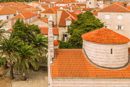 Landscape of Old town Budva: Ancient walls and red tiled roof. Montenegro, Europe. Budva is one of the best preserved medieval cities in the Mediterranean and most popular resorts of Adriatic Riviera. Stock Photo