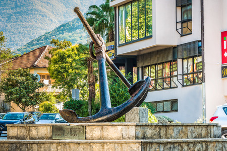 Tivat, Montenegro - August 24, 2017: Anchor on the pedestal. HE weighs 1000 kilograms and is produced almost 150 years ago.