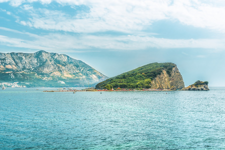View of the island of St. Petersburg Nicholas in the Gulf of the Adriatic Sea near the town of Budva, the famous tourist resort of Montenegro. Stock Photo
