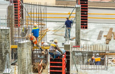 Kiev, Ukraine - May 20, 2018: Workers are working on the construction site. Concrete construction works. Publikacyjne