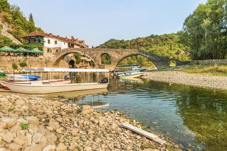 Podgorica, Montenegro - August 26, 2017: Old arched stone bridge across the river Crnojevic.