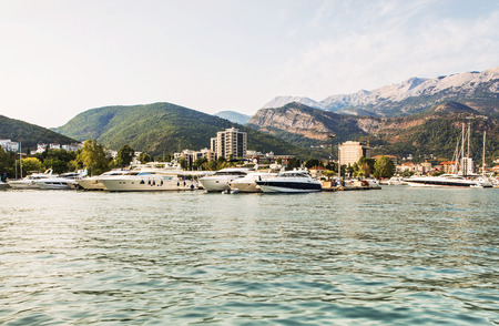 Marina for sailing yachts and boats with a view of the city of Budva and the Balkan Mountains, Budva Riviera, Montenegro. Imagens