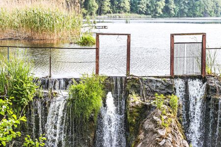 Fragment of a dam with an artificial waterfall