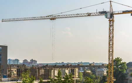 A fragment of the construction of a residential building with a construction crane in the center of Kiev, Ukraine. Stock fotó