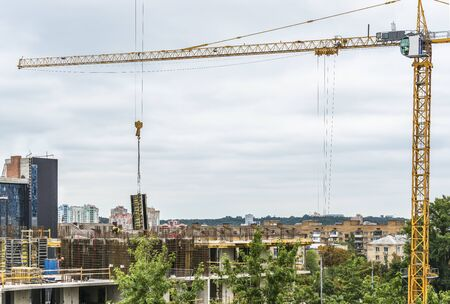 A fragment of the construction of a residential building with a construction crane in the center of Kiev, Ukraine. Stock fotó - 129488497