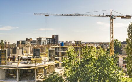 View of the construction of a high-rise apartment building in the center of Kiev, Ukraine. With the help of tower cranes, concrete work is carried out on the fifth floor. Stock fotó - 129488510