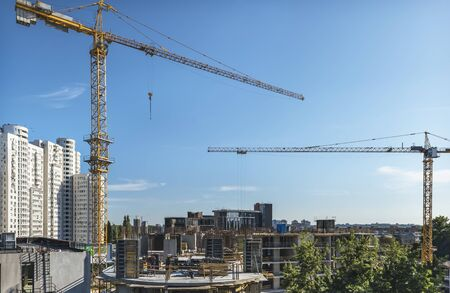 A fragment of the city of Kiev, Ukraine. In the foreground are tower cranes over one of the new buildings, as well as constructed residential and office buildings. Stock fotó
