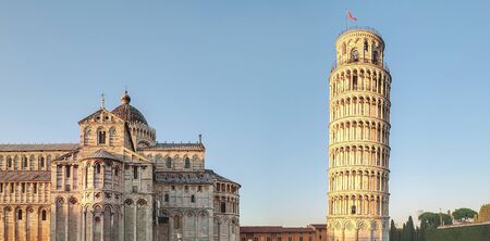 View of the cathedral and the bell tower (Leaning Tower of Pisa) in the city of Pisa, Italy.