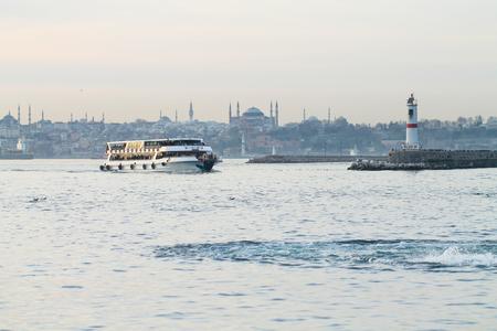 The white ship goes to the Kadikoy station. Istanbul. Turkey.