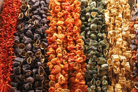 The dried vegetables suspended on a thread. Banco de Imagens