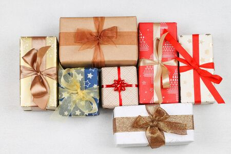 The gift boxes of different colors with bows. Christmas