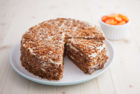 Homemade carrot and walnut cake on a wooden table photo