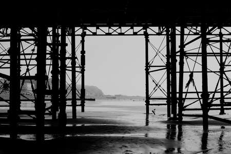 rebuilt: The silhouette of the new Hastings pier which was rebuilt and open to public in 2016, photo against the sun, special effect filter applied, East Sussex. England