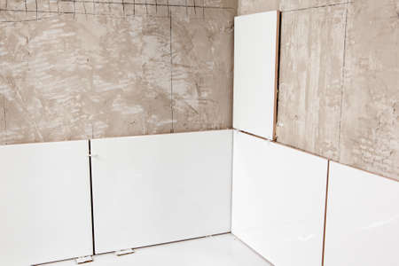 tiling: Unfinished wall tiling Stock Photo