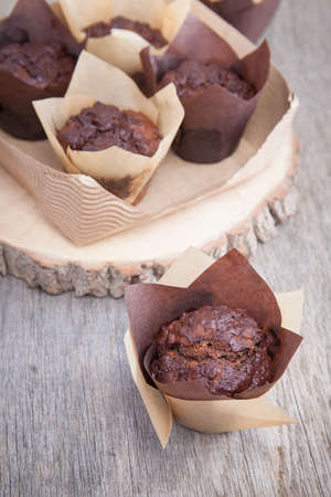flourless chocolate cake: Flourless chocolate courgette muffins on a wooden table