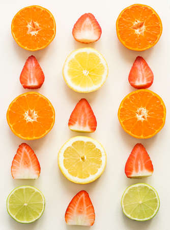 Top view of citrus fuits and strawberries, on the white background
