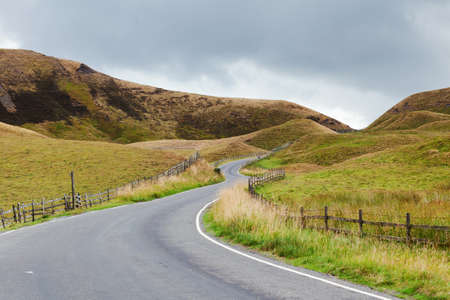 Peak District National Park, Derbyshire, England. Walks in Mam Tor, view of the hills and road selective focus Stock Photo