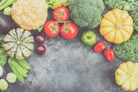 Top view of vegetables on the dark grey background, copy space for text below, selective focus, toned Stock Photo