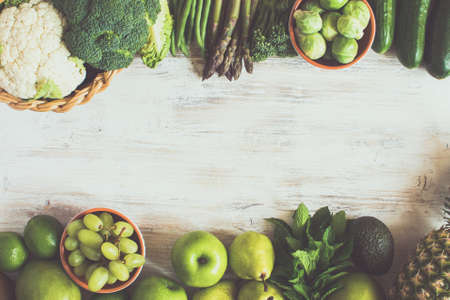 Top view of green fruits and vegetables on the white table with copy space for text, selective focus, toned Stock Photo