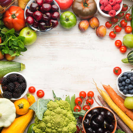 Healthy living, summer fruits vegetables berries arranged in a circle frame. Organic produce, raw eating, copy space, top view, square, selective focus