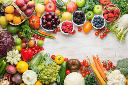 Healthy eating, summer fruits vegetables berries, cherries peaches strawberries cabbage broccoli cauliflower squash tomatoes carrots spring onions beans beetroot, copy space, top view, selective focus