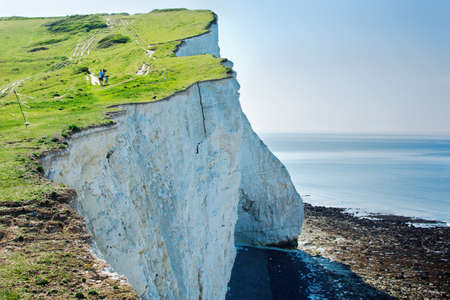 View of the white chalk cliffs in the morning, Seaford, East Sussex, England, part of Seven Sisters National park, selective focus. View of the crack on the cliff Stock Photo