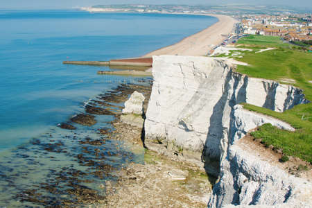 Seaford Head, East Sussex, England. View of the white chalk cliffs and the town in the morning, part of Seven Sisters National park, selective focus