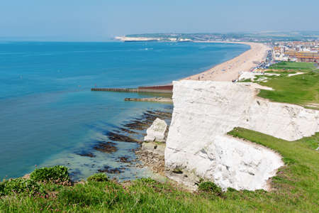 Seaford Head, East Sussex, England. View of the white chalk cliffs, blue sea to the west in the morning, part of Seven Sisters National park, selective focus