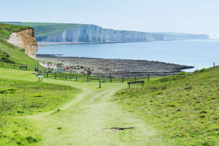 Seaford Head Naturue reserve, East Sussex, England. View of the chalk cliffs, part of Seven Sisters National park in the morning haze, path to the Beachy head, selective focus