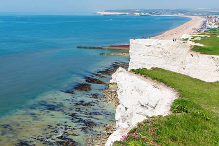 Seaford Head, East Sussex, England. View of the white chalk cliffs to the west in the morning, part of Seven Sisters National park, selective focus Stock Photo