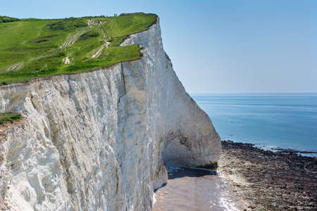 View of the white chalk cliffs in the morning, Seaford Head, East Sussex, England, part of Seven Sisters National park, selective focus. View of the crack on the cliff