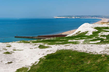 Seaford Head, East Sussex, England. View of the white chalk cliffs and sea to the west in the morning, part of Seven Sisters National park, selective focus Stock Photo