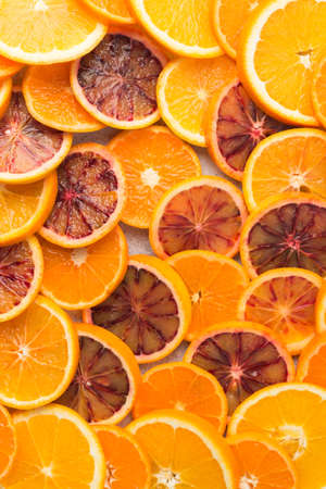 Different varieties of citrus fruits pattern background, overhead view, on white table, selective focus,
