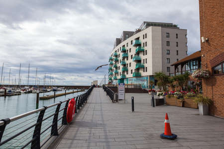 BRIGHTON, ENGLAND - SEPTEMBER 08 2018: Houses and buildings in Brighton Marina, East Sussex, UK, residential and leisure complex on September 08, 2018