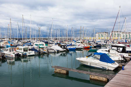 BRIGHTON, ENGLAND - SEPTEMBER 08 2018: Yachts and boats in Brighton Marina, East Sussex, UK, residential and leisure complex on September 08, 2018