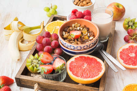 Healthy eating, paleo gluten free nut and fruit granola served with fruits and berries, nut milk, selective focus Stock Photo - 108965471