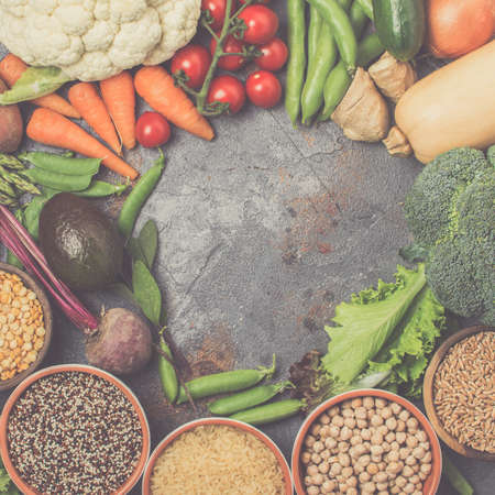 Variety of different vegetables and grains, top view, copy space for text, square, toned, selective focus
