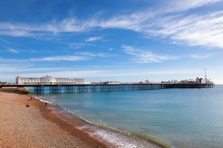 Brighton pier, East Sussex, England on a sunny day, blue sea and sky, selective focus Stock Photo