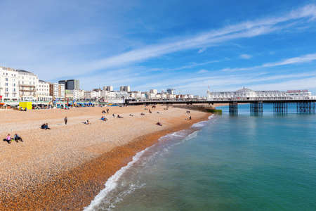 Brighton, England, October 07, 2018. VIew of the Brighton pier with blue sea and shingle beach, selective focus Editorial