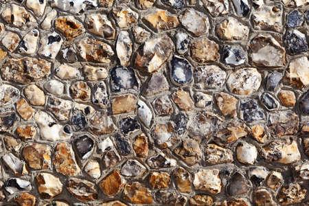Stone wall background on Brighton beach, England, UK