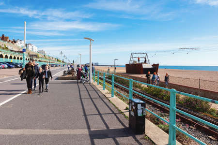 Brighton, England, October 07, 2018. People walking from Brighton Marina to the pier, view of the sea, shingle beach, selective focus Editorial