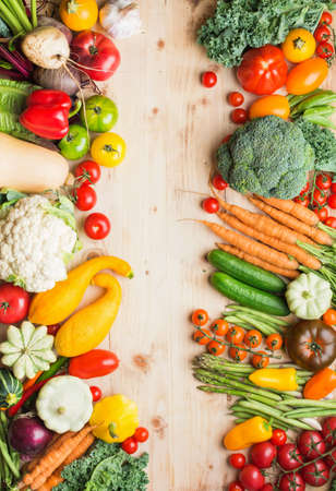 Fresh farm produce, organic vegetables on wooden pine table, healthy background, copy space for text, top view, selective focus Stock Photo