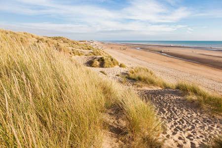 Camber Sands, sandy beach at the village of Camber, East Sussex near Rye, England, the only sand dune system in East Sussex. View of the dunes, grass, sea, selective focus Stock Photo