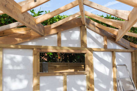 Building summer house or shed in the garden, wooden structure, waterproofed, close up of the roof, selective focus Stock Photo