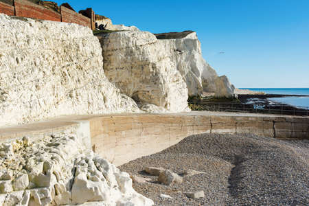 Walk to the splash point in Seaford East Sussex. England, cliffs, sea and the blue sky, view of the remains of the Cliff Cottage or Splash point hotel, selective focus