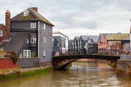 LEWES, ENGLAND - 6 November 2018: landscape of Lewes town with the bridge over the river, shops and old houses, East Sussex, England, UK