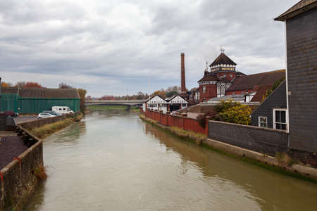 LEWES, ENGLAND - 6 November 2018: Harveys brewery in Lewes town, river, East Sussex, England, UK