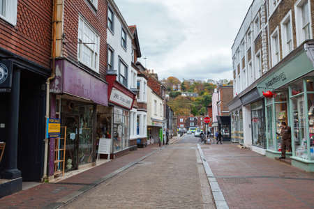 LEWES, ENGLAND - 6 November 2018: Hillside landscape of Lewes town, shops and houses at shopping street, East Sussex, England, UK